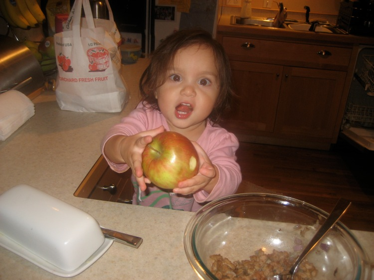 Georgia, helping herself to an apple.
