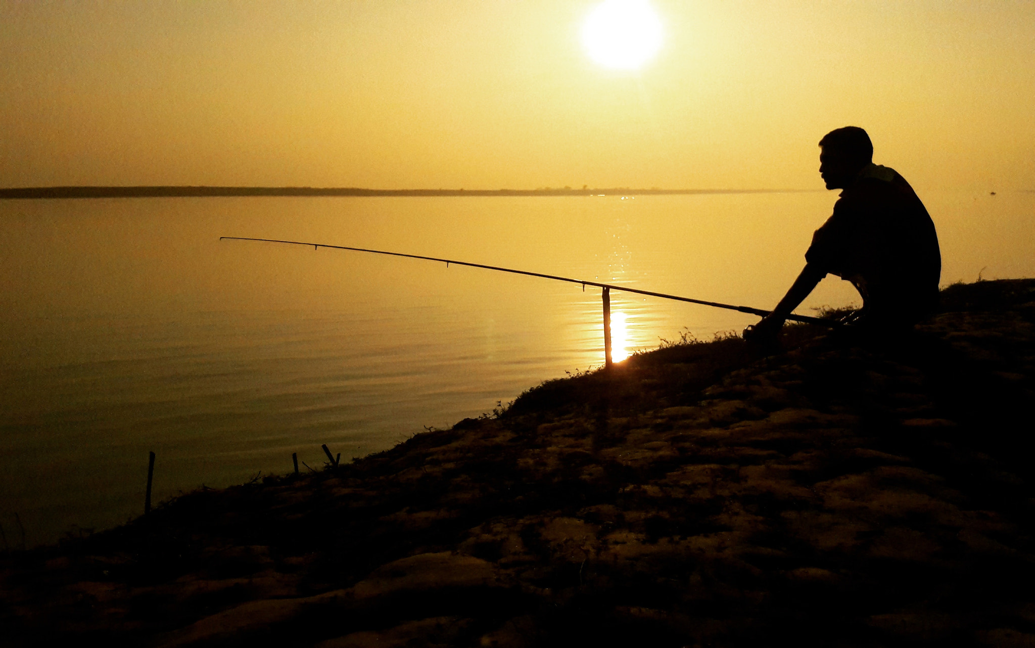 bank_of_river_a_fisherman_is_waiting_for_fish_2818674488329